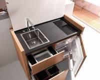 Идеальное решение для тех, кто не знает, как втиснуть все необходимое в крохотную кухню. Фото