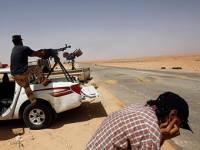 Вооруженные отряды осадили город сторонников Каддафи