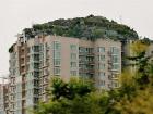 Достали соседи с перепланировками? Китаец построил на крыше многоэтажки целую незаконную виллу