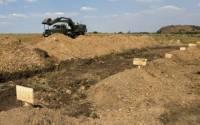 59 российских военнослужащих похоронили в братской могиле под Мариуполем. Вместо имен - номера
