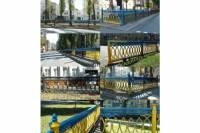 Киевлянин перекрасил сине-желтый забор в центре столицы в черный цвет