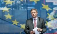 Комиссар Фюле поздравил Украину с выборами