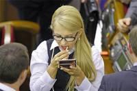В распущенных волосах Тимошенко экстрасенсы усмотрели утраченную силу