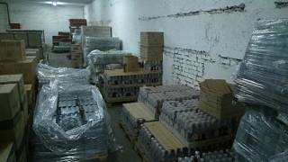 На Харьковском заводе при участии фискалов выпустили сотни тысяч бутылок фальшивой водки