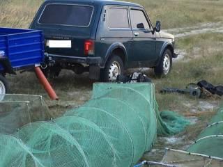 На Кинбурнской косе задержали украинца и двух россиян, выловивших креветок и крабов на 5 млн гривен