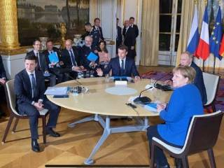 Появились первые кадры встречи Зеленского и Путина в Париже