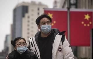 На фоне растущей эпидемии недалеко от столицы Китая ввели военное положение