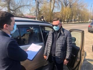 В медицинской маске: полиция задержала министра времен Януковича по подозрению в убийстве