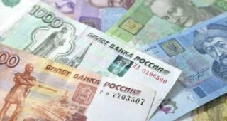 Как и где выгодно обменять рубли на гривны