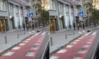 В центре Киева полуголая девушка на глазах у копов станцевала стриптиз
